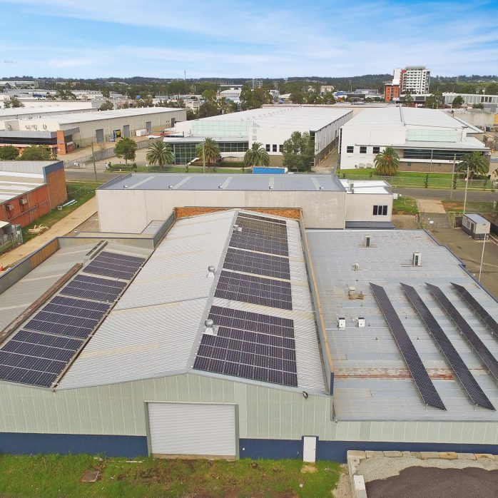 Lots of solar panels installed on the roof of commercial factory